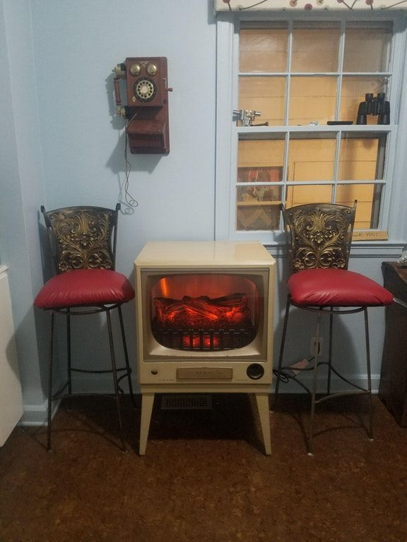 I put an electric fire insert in a old 50's tv and use it as a kitchen table. : mildlyinteresting