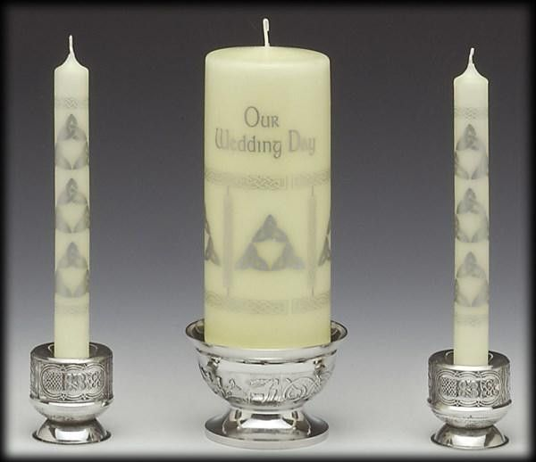 DOES NOT INCLUDE CANDLES. Center pillar candle holder and two side candle holders. Perfect for a unity candle for a wedding, but set can be split up for everyday use. Exquisite Celtic design. Comes bo