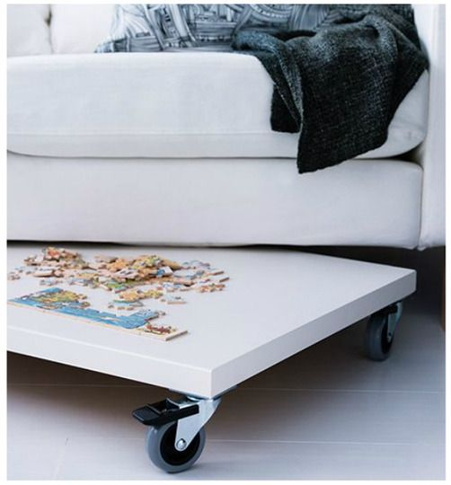Small Space Solutions from the 2012 IKEA Catalog  A PRÄGEL countertop on casters takes advantage of overlooked areas like under low furniture.