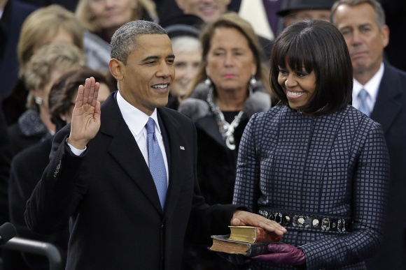 President Barack Obama receives the oath of office from Chief Justice John Roberts as first lady Michelle Obams and his daughters Malia and Sasha look on at the ceremonial swearing-in at the U.S. Capitol during the 57th Presidential Inauguration in Washington, Monday, Jan. 21, 2013.
