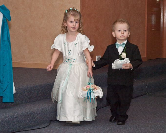 Grace and Caleb - my gorgeous grandchildren!  I made Grace's dress and the ring cushion carried by Caleb.  Silk ribbon embroidery decorations.