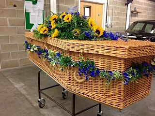sun flower and blue delphinium funeral flowers, casket garland, coffin spray www.thefloralartstudio.co.uk