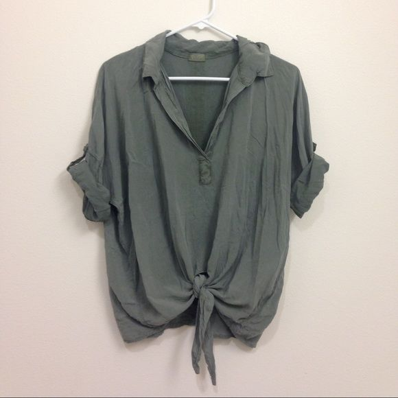 "Brandy Melville Army Green Tie Front Shirt Deep ""V"" blouse with a front tie. This is one size fits most, but it seems to best fit around a small or medium. Great for dressing up or down. Brandy Melville Tops Blouses"