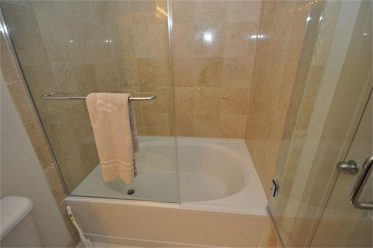 Small Tub And Shower Combo: Bathroom, : Soaker Tub Shower Combo With Folding Glass