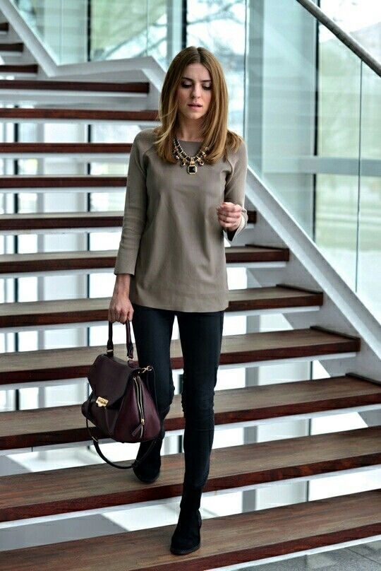 Black slacks with oversized jumpers and statement necklace.   Office Style