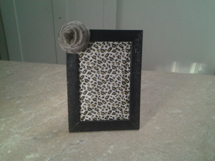 Use an old broken picture frame with no glass and add some wrapping paper of your choice and glue a single lace flower to 1 of the corners xxx