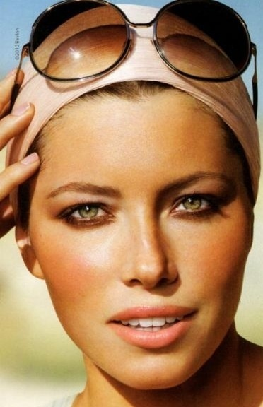 The ultimate Summer look, bronzey skin with peach lips and cheeks. Try Jouer's Cherish lip gloss to get the look.