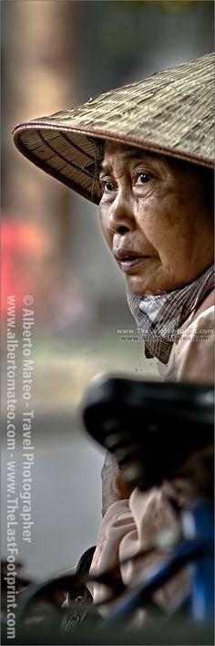 Portrait of woman, street seller in Hanoi old quarters, Vietnam. Photograph byAlberto Mateo, Travel Photographer.