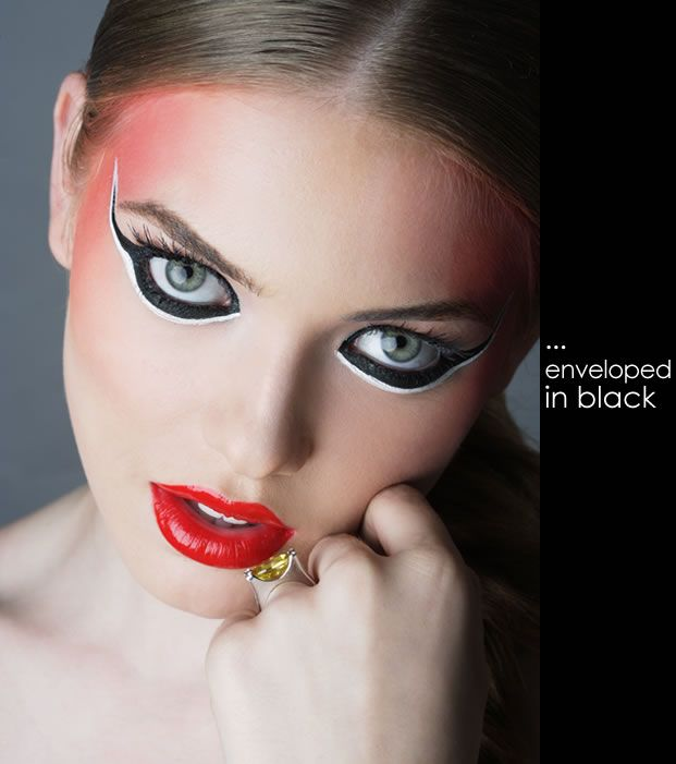 black & white eyeliner combo with bold red lips