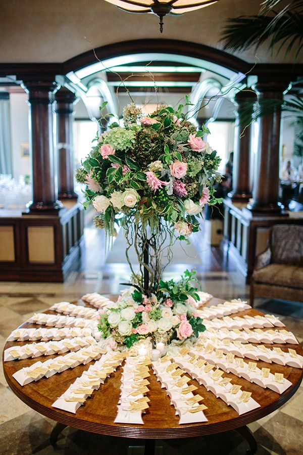 elegant escort card table at country club reception #escortcard #elegantwedding #weddingchicks http://www.weddingchicks.com/2014/03/11/newport-beach-glittery-pink-wedding/