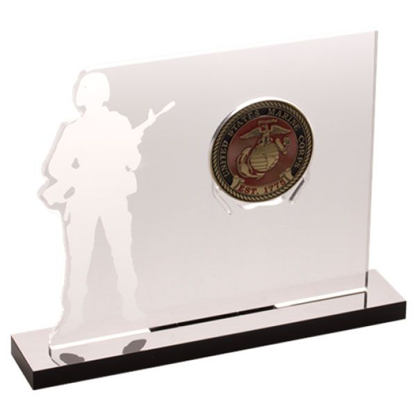 """This one-of-a-kind acrylic coin stand features the silhouette of an armed service member. The stand is 5"""" in height and 6.5"""" in length and holds one 1.75"""" inch coin, the standard size of a challenge coin. Display a special military coin in your home with this."""