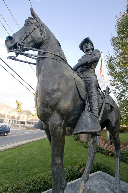 """Located in his home town of Oyster Bay, NY, honoring our 26th president from his days as a Rough Rider, with his horse Little Texas. TR received a posthumous Medal of Honor for leading the dual charges up Kettle Hill and San Juan Hill in Cuba during the Spanish-American War in 1898. After his return he preferred to be known as """"Colonel Roosevelt"""" or """"The Colonel""""."""