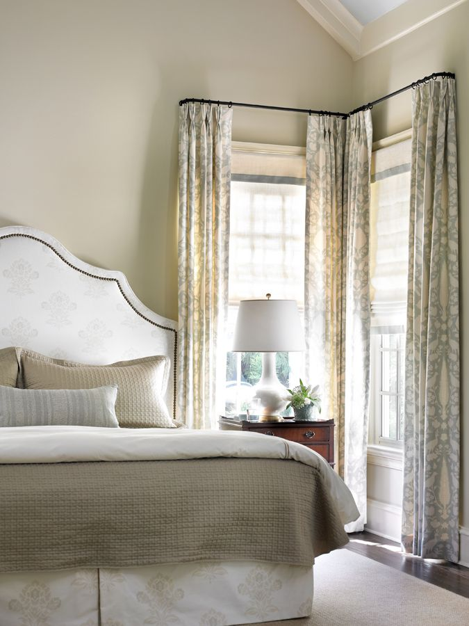 "Add the illusion of height by hanging drapery panels above window casing by 6"" or more at ceiling. Master bedroom by Holt Interiors"