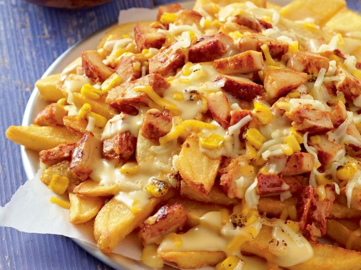We did some California dreaming and had some fun in the kitchen loading thick-cut steak fries with gooey cheese sauce, fire-roasted corn, chicken and more cheese! - Chef Katie