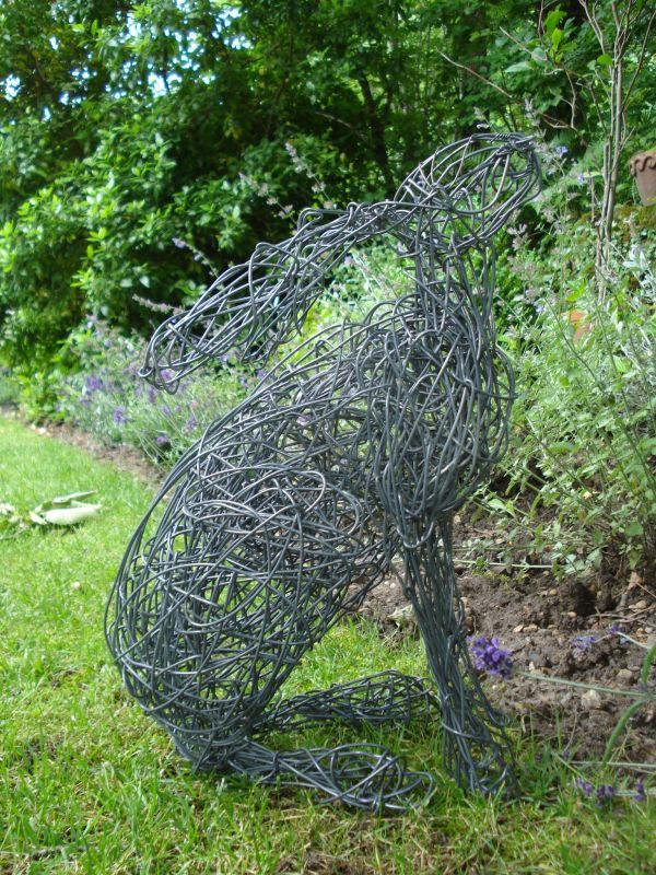 a sculpture titled moon hare 4 wire mad march seated garden sculpture sculptures for salewire