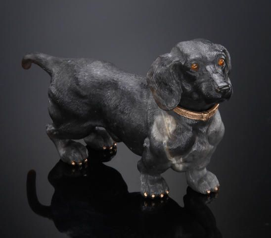 FABERGÉ~ Black Obsidian Carving of a Dachshund. The carved stone animals of FABERGÉ were highly prized and collected by the Russian nobility and the royal families of all Europe.