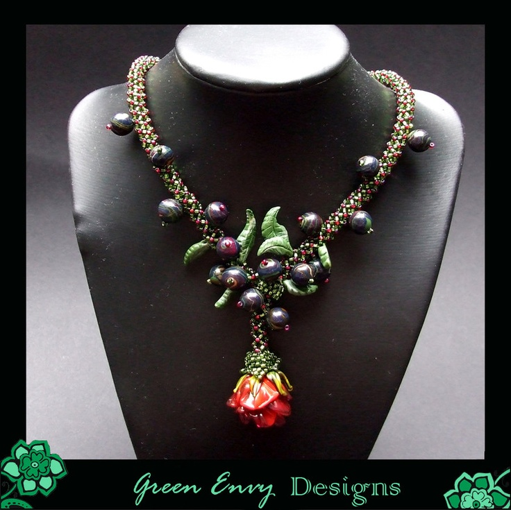 necklace that features a stunning lampwork rose focal by urban-oasis. the claybeads are made by my friend immortal designs and the beadwork and design are my input :) - private collection