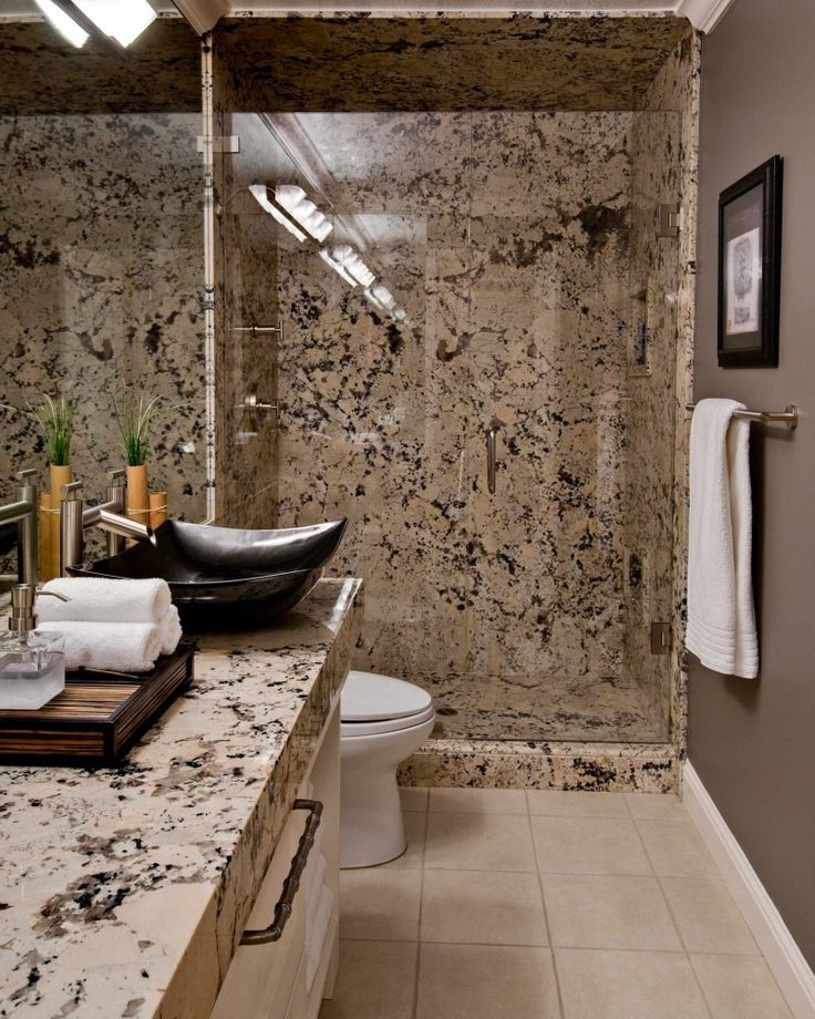 ice brown granite countertop brown granite wall glass shower door brown wall black floating sink of Installing Ice Brown Granite Countertop for Your Home Design