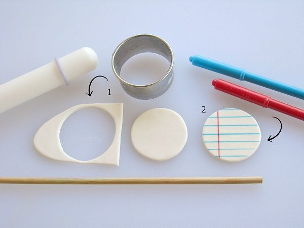 Make a cute notebook paper cutout for your back to school cupcakes
