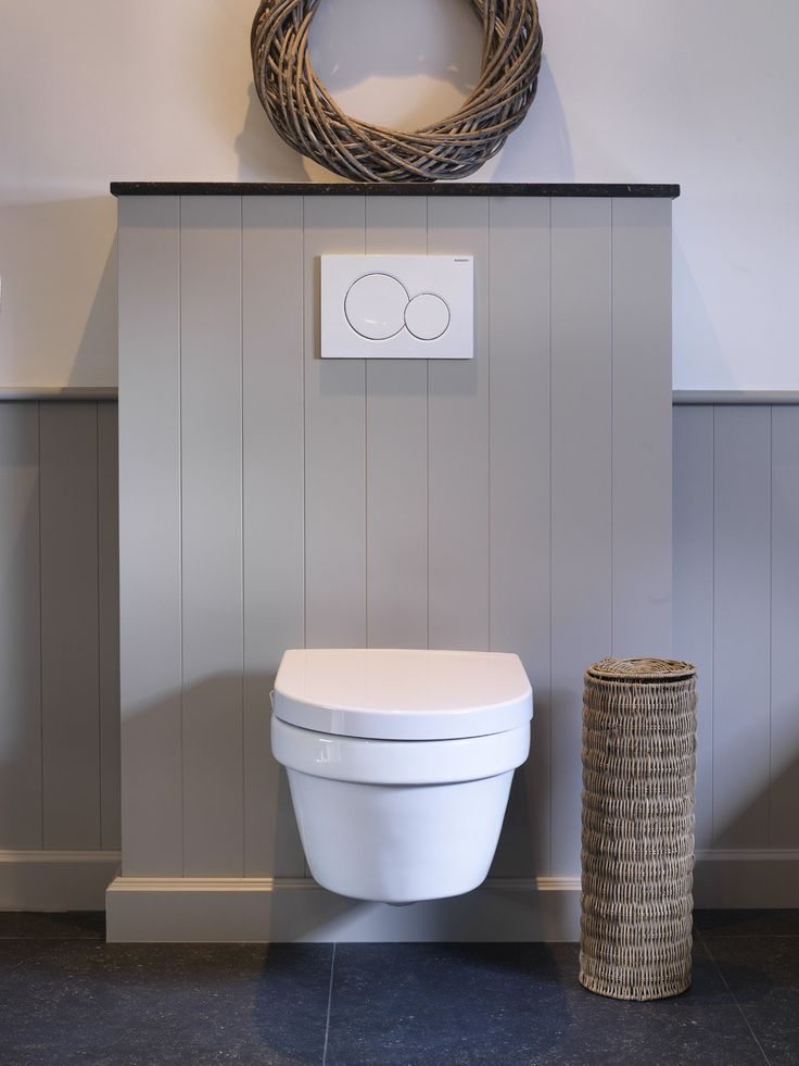 Beautiful toilet surround in cottage style. The natural stone top plate finishes the look.