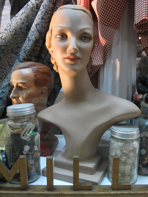 Classic Purfex mannequin form in historical mannequin exhibition at Lopdell House Gallery.