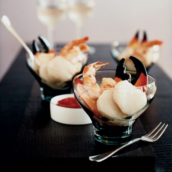 Smoky Seafood Cocktails | Here, Grace Parisi revamps the classic shrimp-cocktail recipe by including scallops and stone-crab claws, then tweaks the cocktail sauce by replacing the ketchup with bottled chile sauce and seasoning it with hot pimentón de la Vera and prepared horseradish.