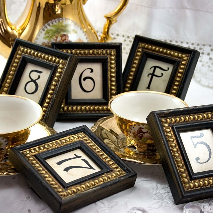 Table #s black and gold wedding