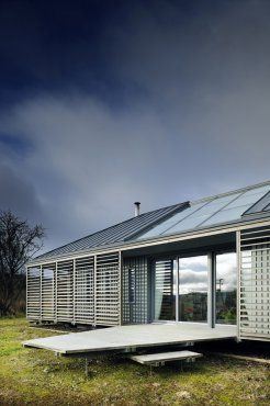 Roderick James Architects - timber pavilion with metal roof and louvred walkway