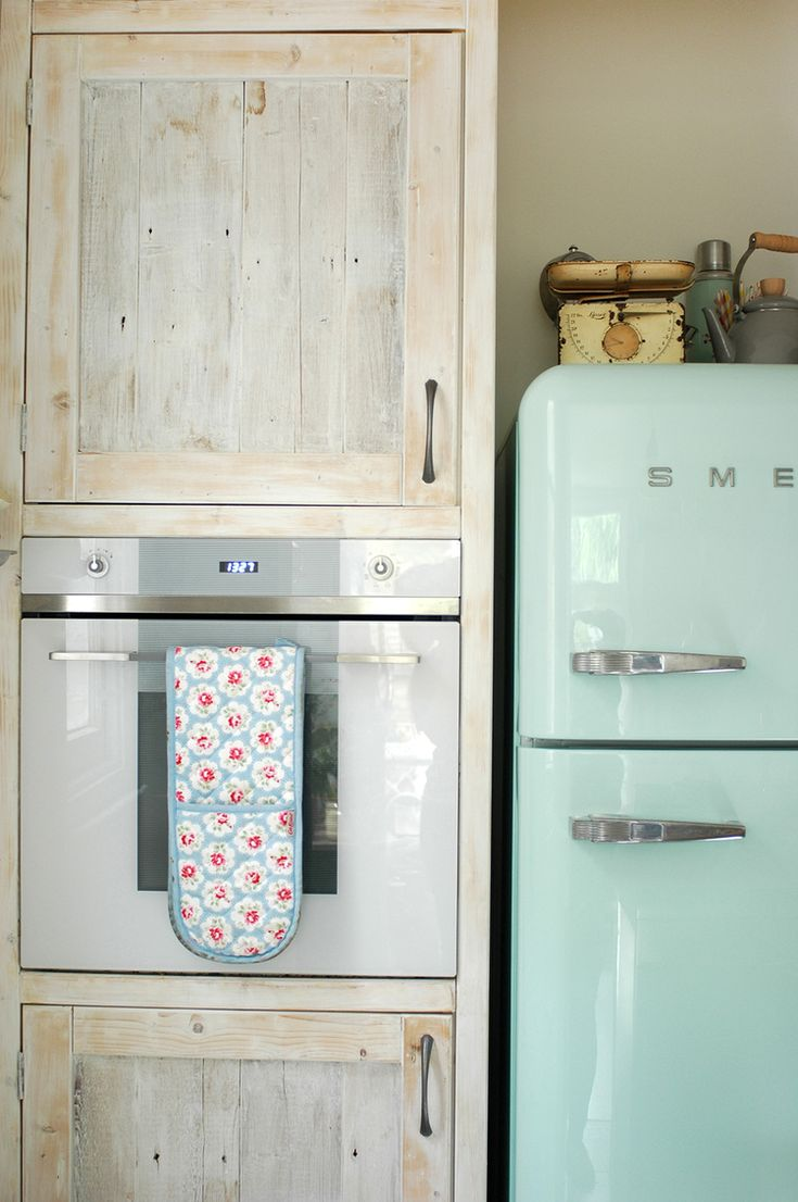 Kitchen - mint green smeg fridge, reclaimed white washed cupboards, smeg oven & vintage finds.