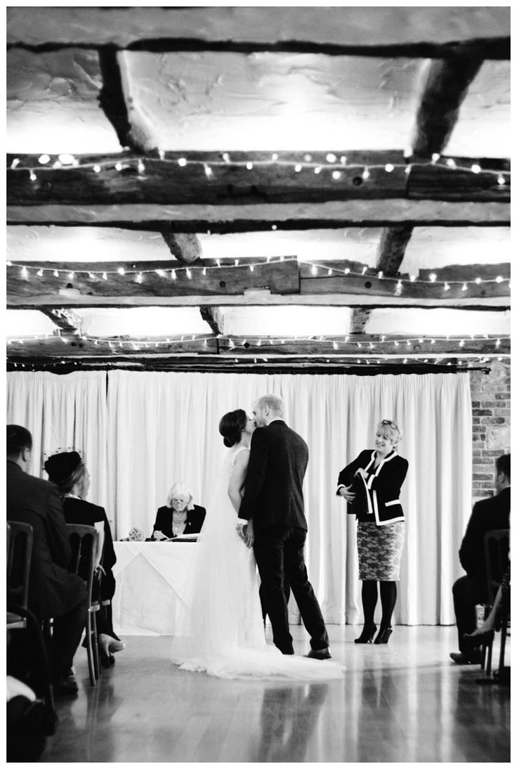 Black and white bride and groom kiss after vows at high rocks wedding ceremony www.ellen-richardson-weddings.com