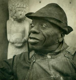 William Edmondson was the first black artist to have a solo show at the Museum of Modern Art (MOMA), New York in 1937. He grew up near Nashville, Tennessee. Edmondson's father, George, died when he was quite young and his mother Jane became a farm worker to support the family. With a belief that his work was inspired by God, Edmondson began carving tombstones and later expanded his work to include sports heroes, animals, birdbaths, and figures from the Bible.