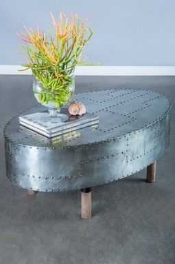 Studded metal oval coffee table - neat look.