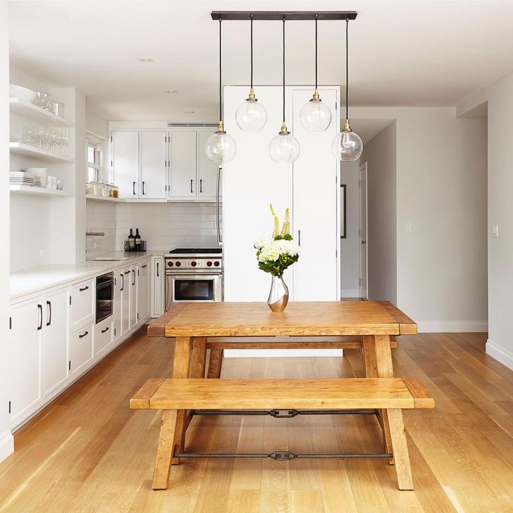 With a very narrow kitchen space, our goal was to make the kitchen and dining area as open to each other as possible while adding storage (the wall behind the dining table).