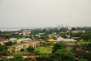 Kinshasa is the capital and largest city of the Democratic Republic of the Congo. Part of the Congo River is in the background.  8.75 Million in capital, 67 million souls in Congo - DRC. 92% Christian.