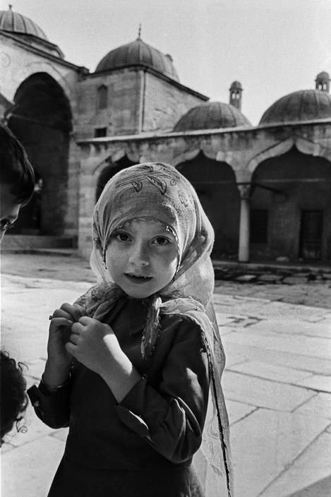Ara Guler TURKEY. 1988. Girl in the courtyard f the Sokollu Mehmet Pasha Mosque at Kadirga.