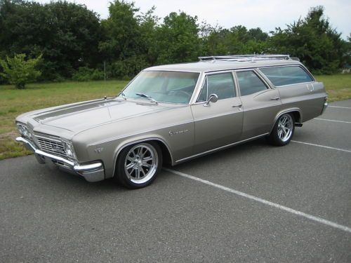 1966 Chevrolet Impala Wagon- Had this one in Blue Impala SS. You could load your whole house in the back and still have room for the dog.