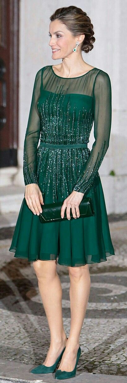 Queen Letizia - Felipe Valerla hunter #green cocktail dress. The fit-and-flare frock  features an illusion neckline with sheer long sleeves. It has a nipped waist and is finished with hand-sewn tonal beads. Bespoke green patent leather clutch by Felipe Varela, and Magrit's signature 'Leonor' pumps in custom green suede.