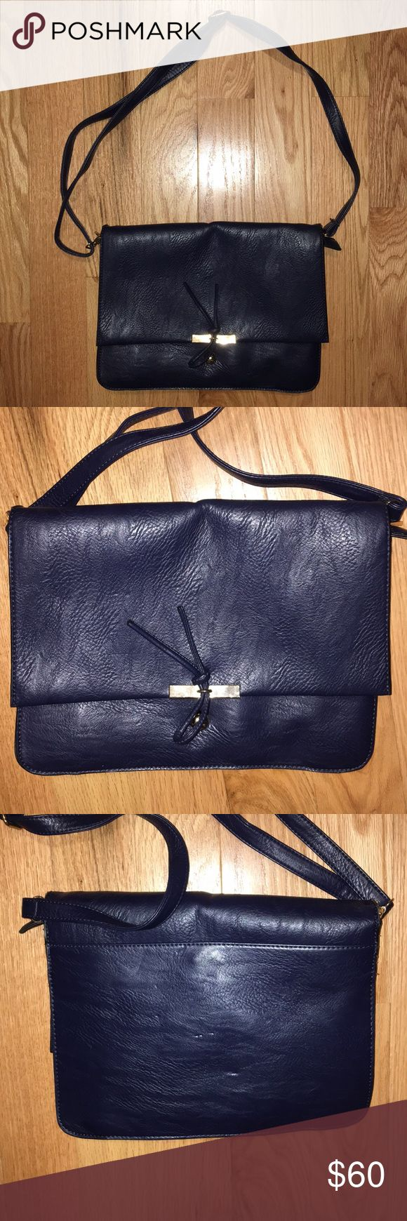 Premium Leather Bag Premium Leather Bags Soft navy leather in great condition barely used. Multiple pockets and zippers inside. Can also fit an iPad or 11 inch laptop. Price is negotiable! Let me know if you have any questions. Bags Crossbody Bags