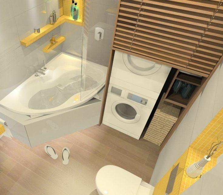 Waschamschine und Trockner aufeinander stellen und im Bad integrieren