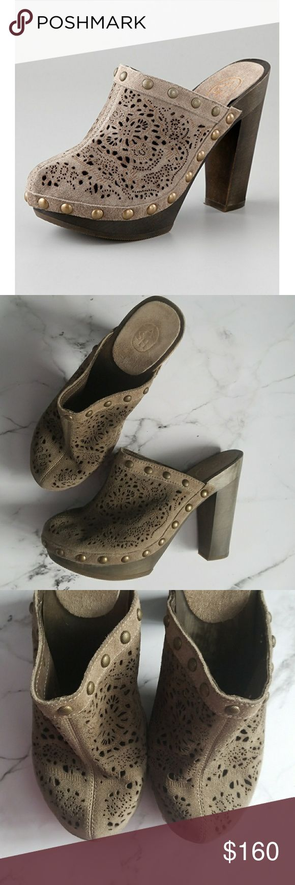 """Ash Spicy Cutout High Heel Clogs These distressed suede platform clogs feature a laser cutout pattern and studded edges. Wooden platform and wooden heel. Rubber sole. Taupe in color.  New without box.  Size could not be found but fits about a size 7.5/8. Heel height measures 4.5"""" with a platform of 1"""" Ash Shoes Mules & Clogs"""