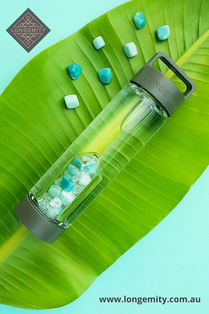 Longemity.  Harmony. Amazonite and Clear Quartz crystal Infused Water Bottle, with interchangeable Gem Pod. Crystal Gem Water. Crystal Elixir.  Crystal Water Bottle. We ship world wide. www.longemity.com.au