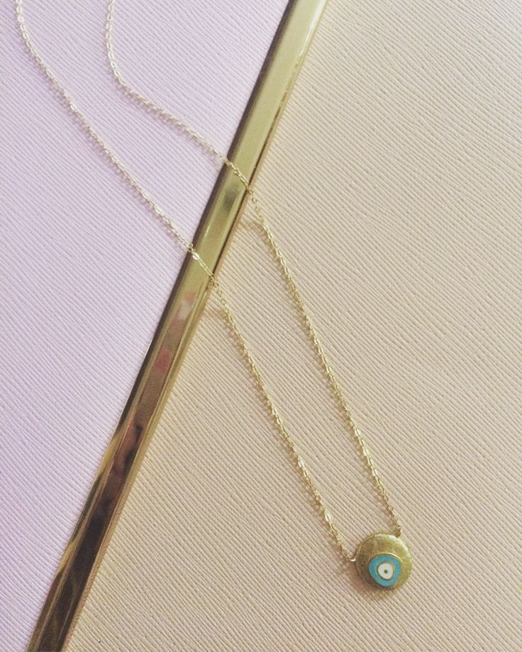 Gold necklace with an eye. It's the latest trend and you can find it on www.goldentiara.gr