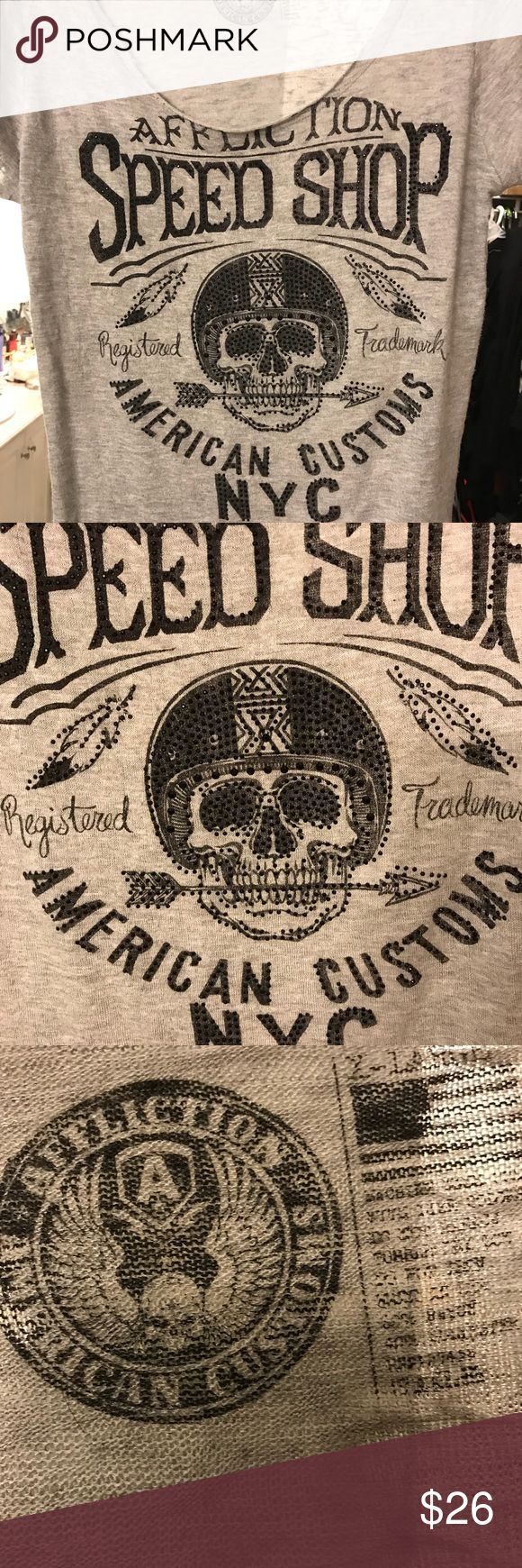 Affliction Scoop next T shirt Grey scoop neck T Shirt with black sequined detailing in the front . It's light grey. It also runs short meaning it's not a good tuck in shirt but very cute in great shirt Affliction Tops Tees - Short Sleeve