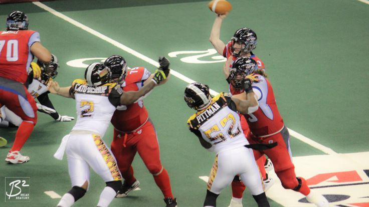 The Portland Thunder's offensive line blocks for QB Kyle Rowley.