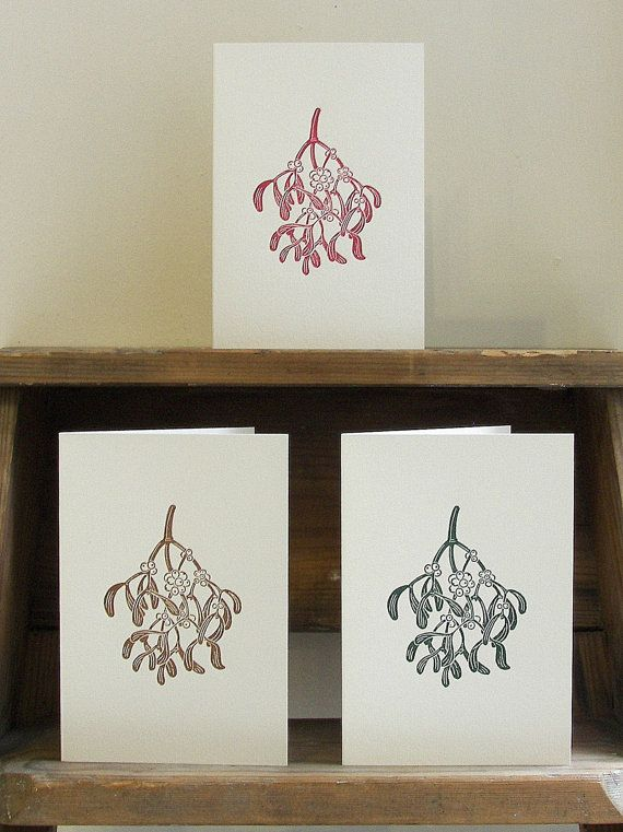 A handmade mistletoe linocut Christmas card, available in red, brown, or green ink, by Inkshed Press.