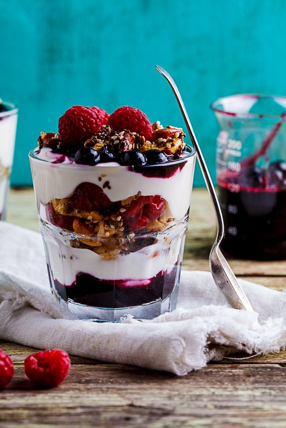 Quick and easy breakfast berry parfaits with low-carb nut and seed granola and blueberry sauce.