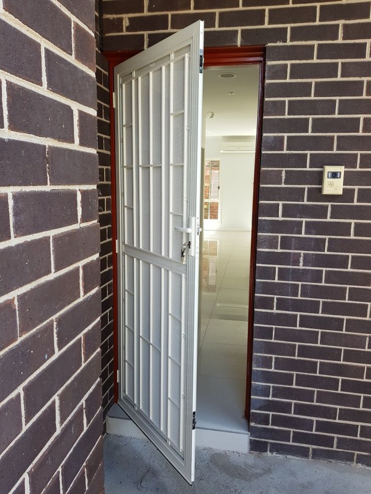 Colonial grill security door with  triple lock