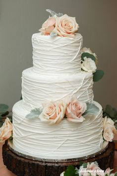 Rustic chic white lined texture wedding cake accented with pink roses; Featured Photographer: Katherine O'Brien Photography