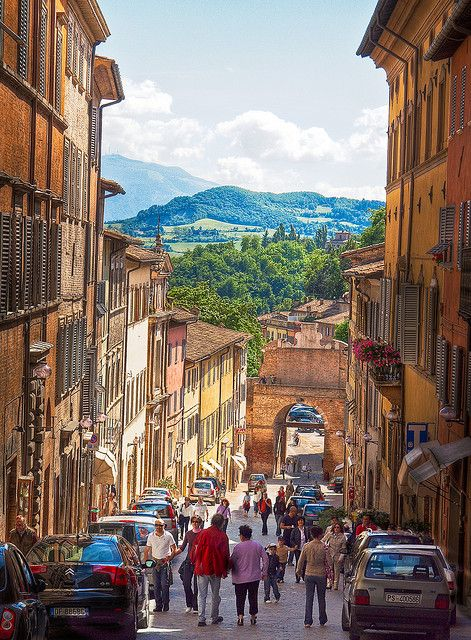 The Via Mazzini in Urbino, Italy Urbino is a walled medieval city and one of the city gates, the Porta Valbona, is at the bottom of the hill.