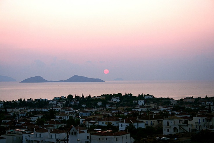 Xenon Estate villas in Spetses - panoramic view during sunrise to the traditional village of the greek island of Spetses as well as of Hydra.  www.xenonestate.gr